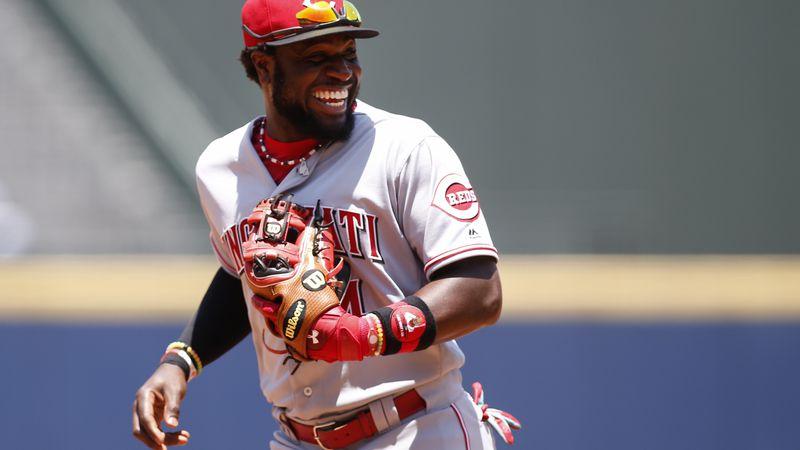 Cincinnati Reds second baseman Brandon Phillips (4) laughs as he runs off the field in the...