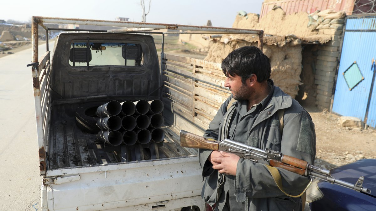 In this Dec. 19, 2020, file photo, an Afghan security official stands near a vehicle in which...