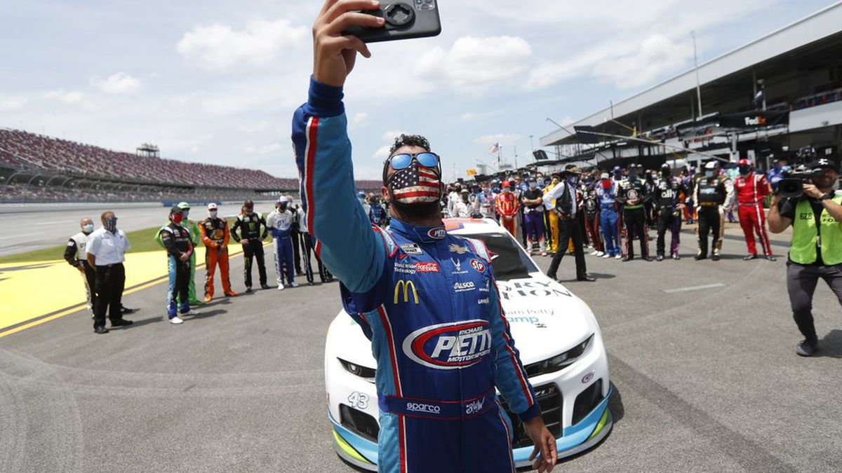 Driver Bubba Wallace takes a selfie with himself and other drivers that pushed his car to the front in the pits of the Talladega Superspeedway prior to the start of the NASCAR Cup Series auto race at the Talladega Superspeedway in Talladega Ala., Monday June 22, 2020. In an extraordinary act of solidarity with NASCAR's only Black driver, dozens of drivers pushed the car belonging to Bubba Wallace to the front of the field before Monday's race as FBI agents nearby tried to find out who left a noose in his garage stall over the weekend. (AP Photo/John Bazemore)(AP Photo/John Bazemore | AP Photo/John Bazemore)