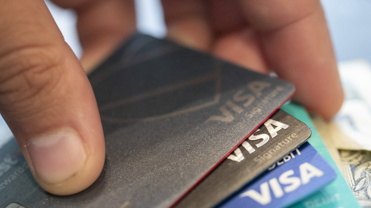 This Aug. 11, 2019 file photo shows Visa credit cards in New Orleans. U.S. consumers reduced...