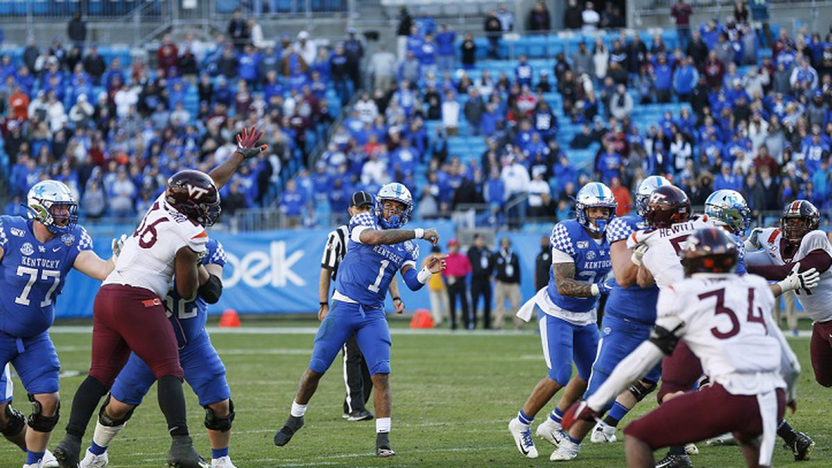 Kentucky quarterback Lynn Bowden Jr. (1) throws the game-winning touchdown pass against Virginia Tech in the final minute of the Belk Bowl NCAA college football game in Charlotte, N.C., Tuesday, Dec. 31, 2019. Kentucky won 37-30. (AP Photo/Nell Redmond)