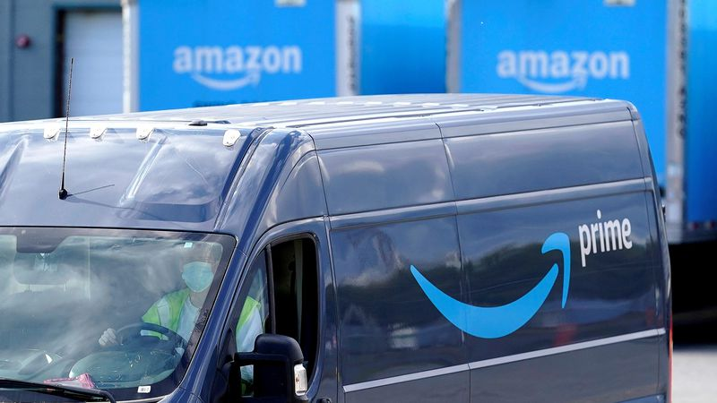 FILE - In this Oct. 1, 2020 file photo,  an Amazon Prime logo appears on the side of a delivery...