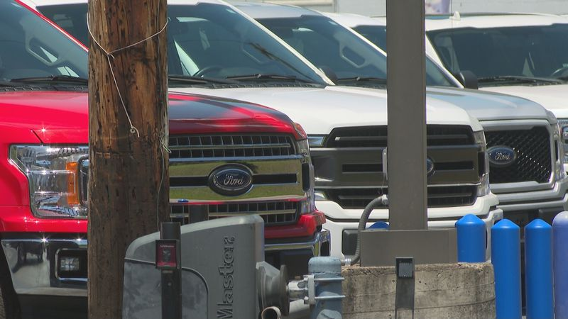 Thousands of Ford trucks line the parking lots of Kentucky Speedway awaiting microchips so they...