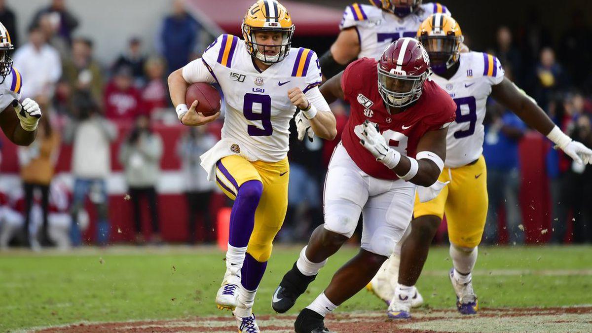 LSU quarterback Joe Burrow (9) runs as Alabama defensive lineman Phidarian Mathis (48) chases him in the first half of an NCAA college football game, Saturday, Nov. 9, 2019, in Tuscaloosa , Ala.