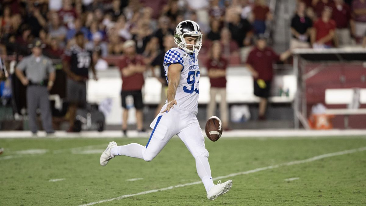 Max Duffy punts during 2019 football season.