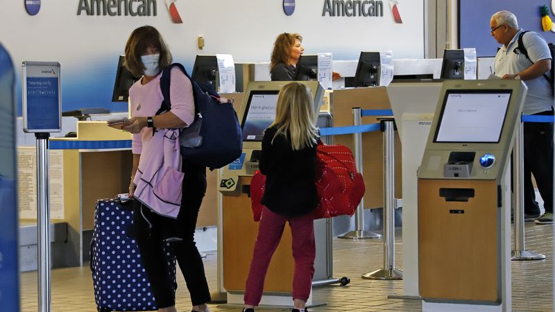 Travelers check in at the American Airline ticket counter at Greater Pittsburgh International...
