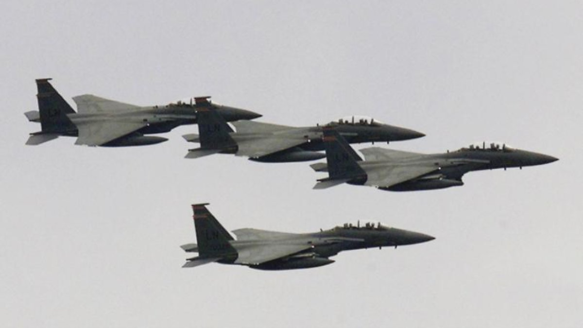 U.S. Air Force F-15's from 194 squadron based at RAF Lakenheath fly past during the...