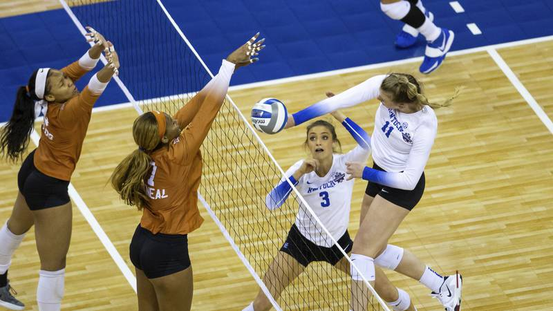 Texas' Asjia O'Neal (7) blocks a spike from Kentucky's Elise Goetzinger (11) during the first...