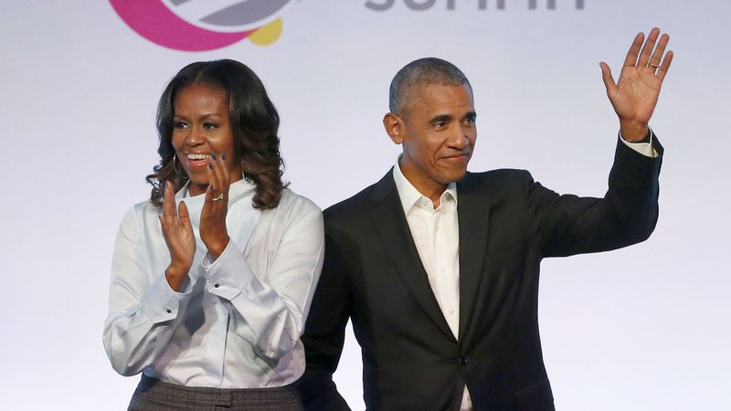 In this Oct. 31, 2017, file photo, former President Barack Obama, right, and former first lady...