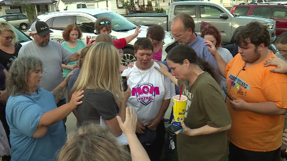 Many surroundin Candus Bly during a prayer circle for her missing daughter Summer Wells.