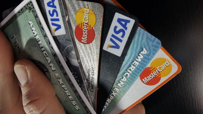 FILE - In this March 5, 2012 file photo, consumer credit cards are posed in North Andover,...