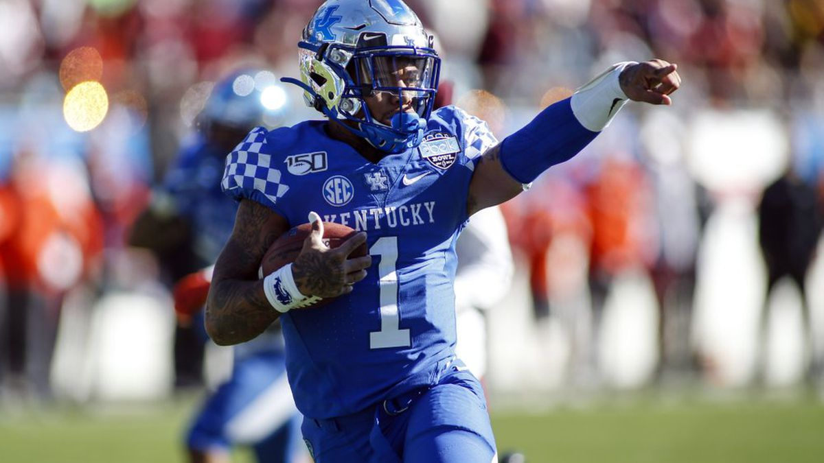 Kentucky quarterback Lynn Bowden Jr. (1) celebrates as he runs 25-yards for a touchdown against Virginia Tech in the first half of the Belk Bowl NCAA college football game in Charlotte, N.C., Tuesday, Dec. 31, 2019.