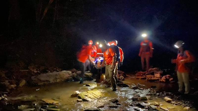 Team members with the Wolfe County Search and Rescue save an injured hiker Sunday night during...