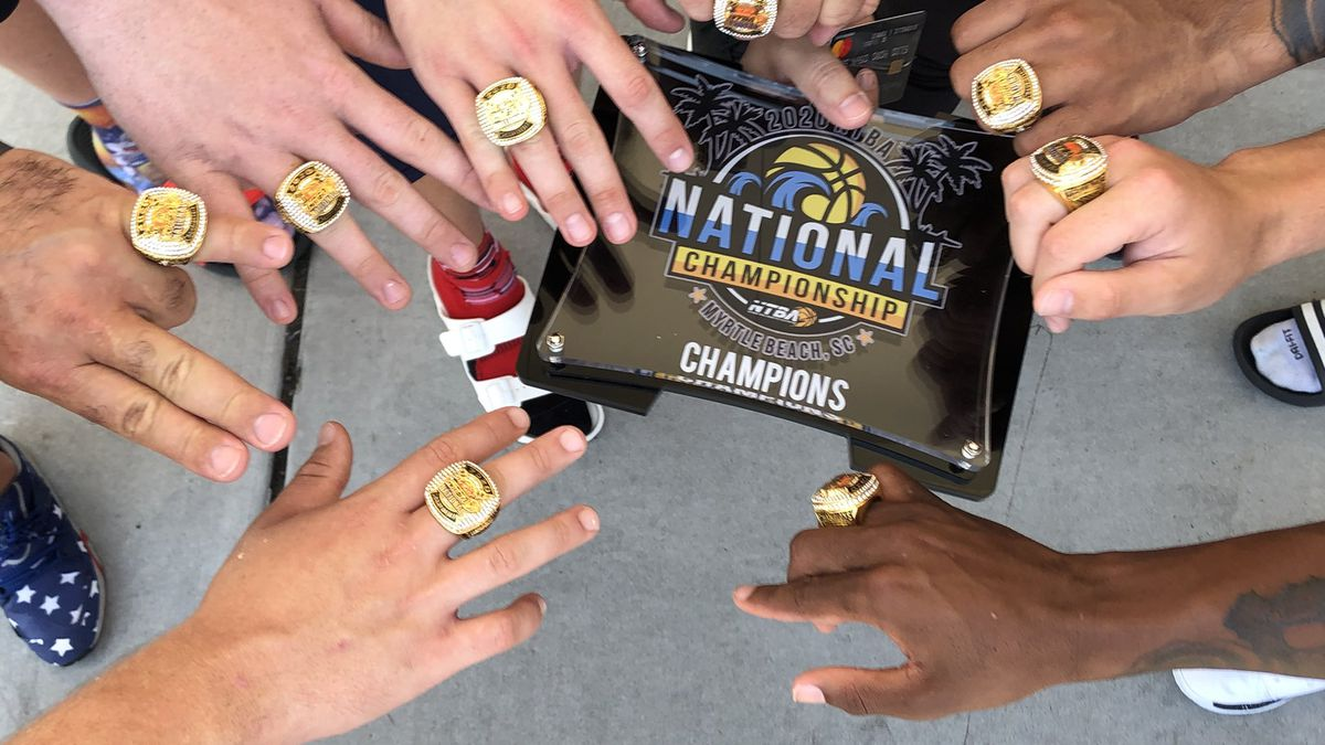 Tri-State Assault shows off their 2020 NTBA National Championship rings.