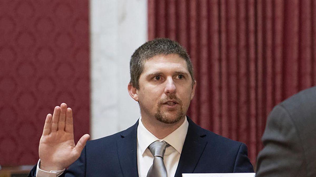 West Virginia House of Delegates member Derrick Evans, left, is given the oath of office Dec....