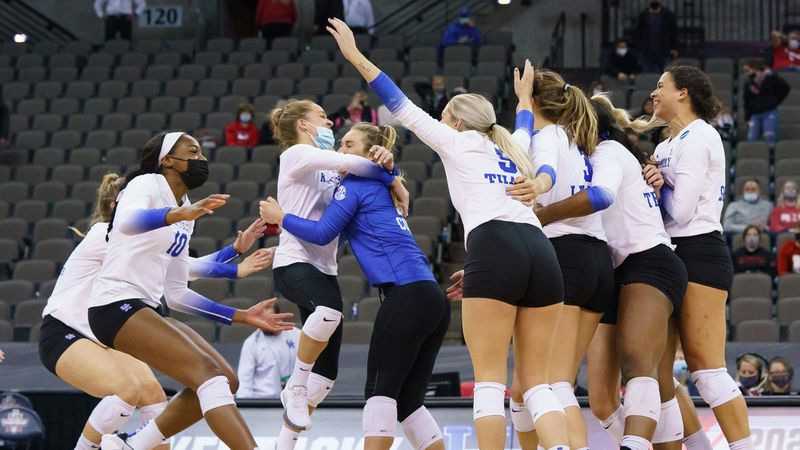Kentucky volleyball celebrates after sweeping Purdue to advance to the program's first-ever...