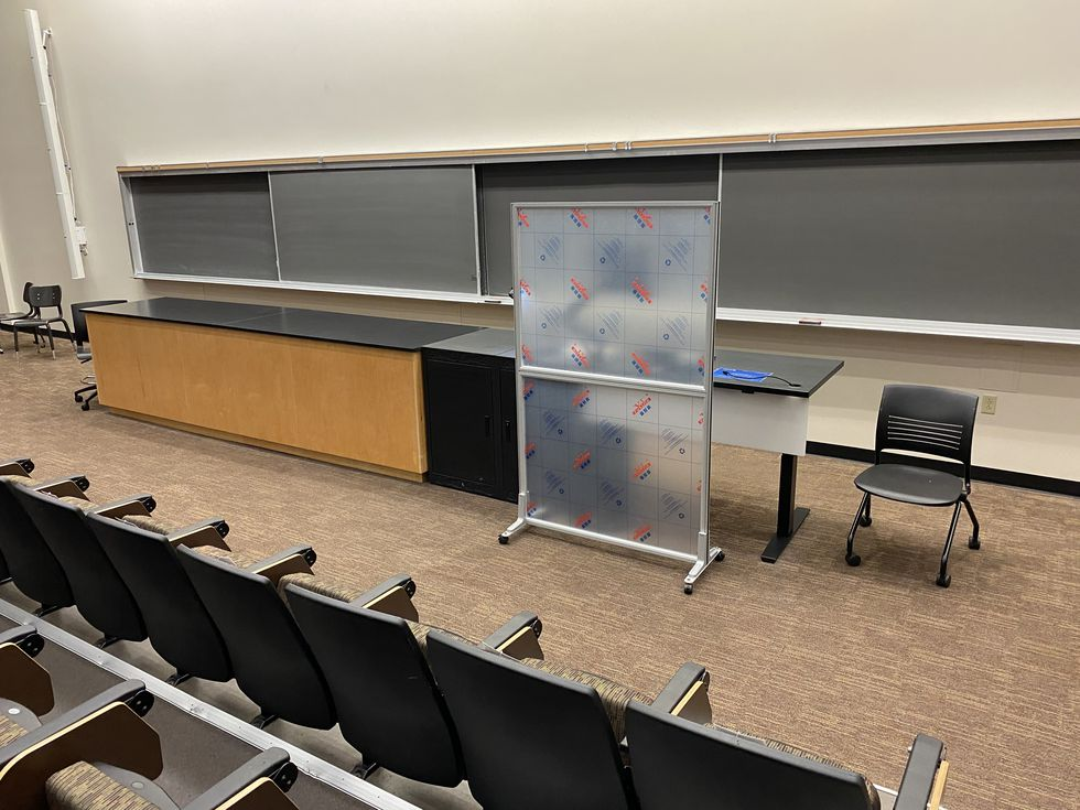 UK bought 375 portable plexiglass partitions in classrooms distancing the professor from the students.