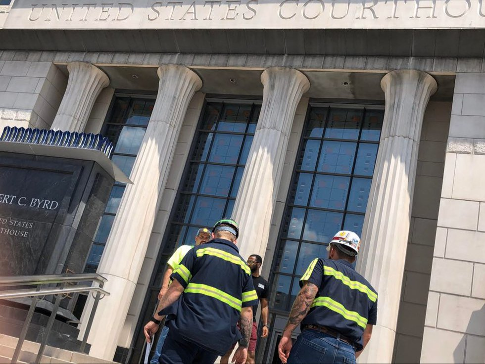 A bus full of Blackjewel miners head to Bankruptcy Court in Charleston, West Virginia to make a...