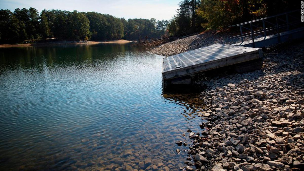 A floating dock sits on the shore as Lake Lanier water levels recede about eight feet below...