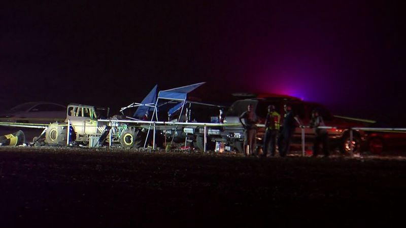The sheriff's office says a vehicle left the mud track and crashed through a guard rail and...