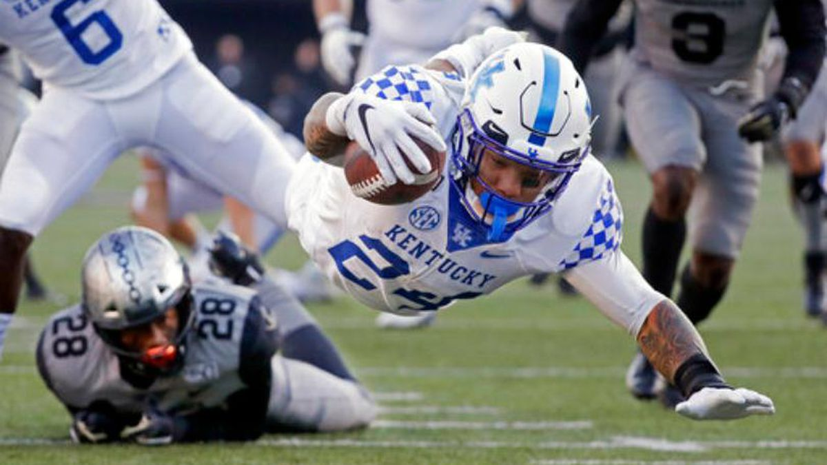 Kentucky running back Christopher Rodriguez Jr. (24) dives into the end zone for a touchdown on a 22-yard run against Vanderbilt in the first half of an NCAA college football game Saturday, Nov. 16, 2019, in Nashville, Tenn.
