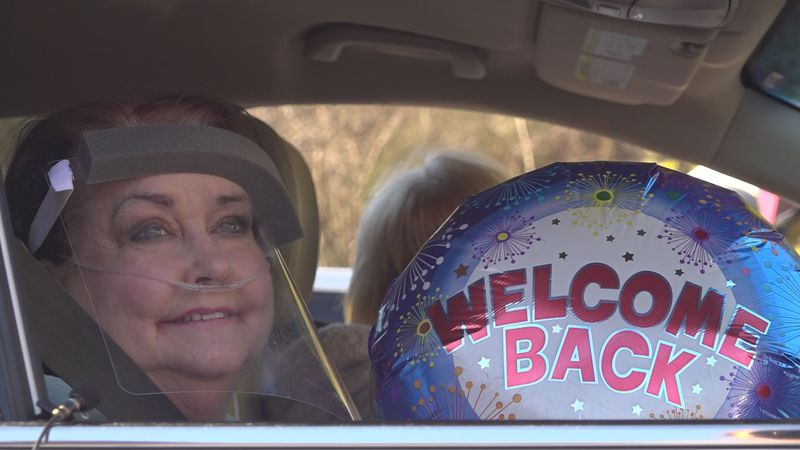 Rita Blackburn was welcomed home to a group of family members Tuesday after nearly two months...