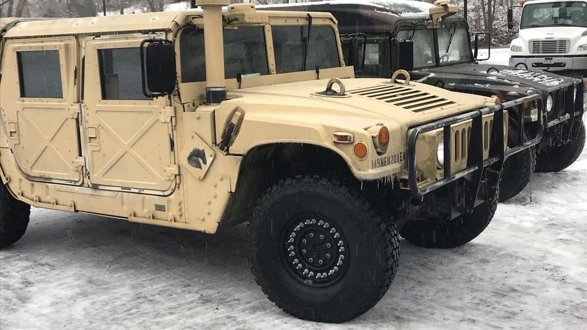 National Guard members are on duty in Boyd County, Kentucky, helping people who can't leave...