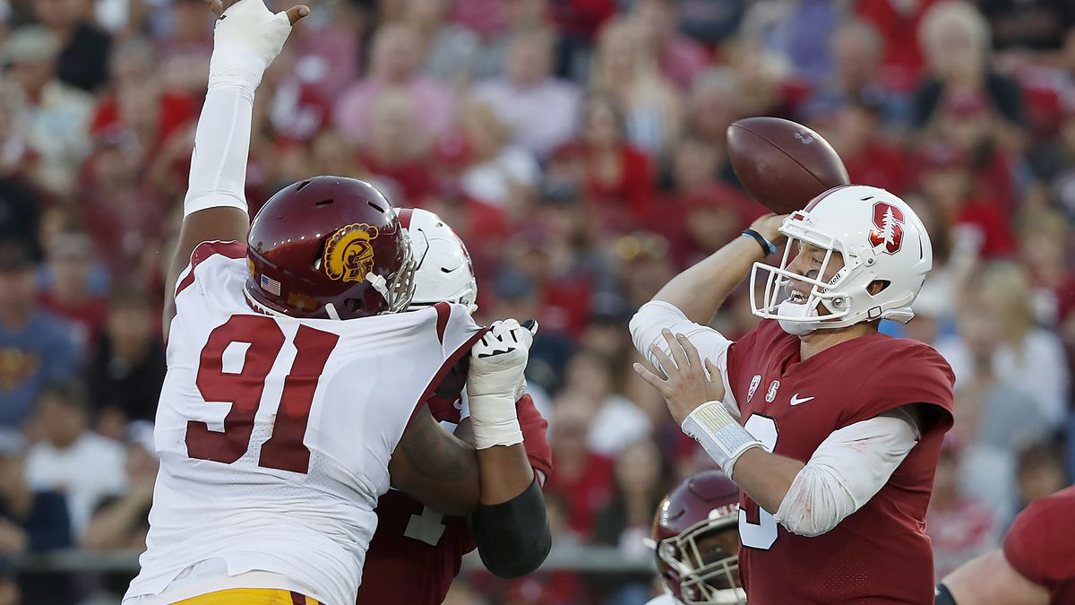Stanford quarterback K.J. Costello (3) throws a pass under pressure by Southern California defensive lineman Brandon Pili (91) during the first half of an NCAA college football game, Saturday, Sept. 8, 2018, in Stanford, Calif. (AP Photo/Tony Avelar)