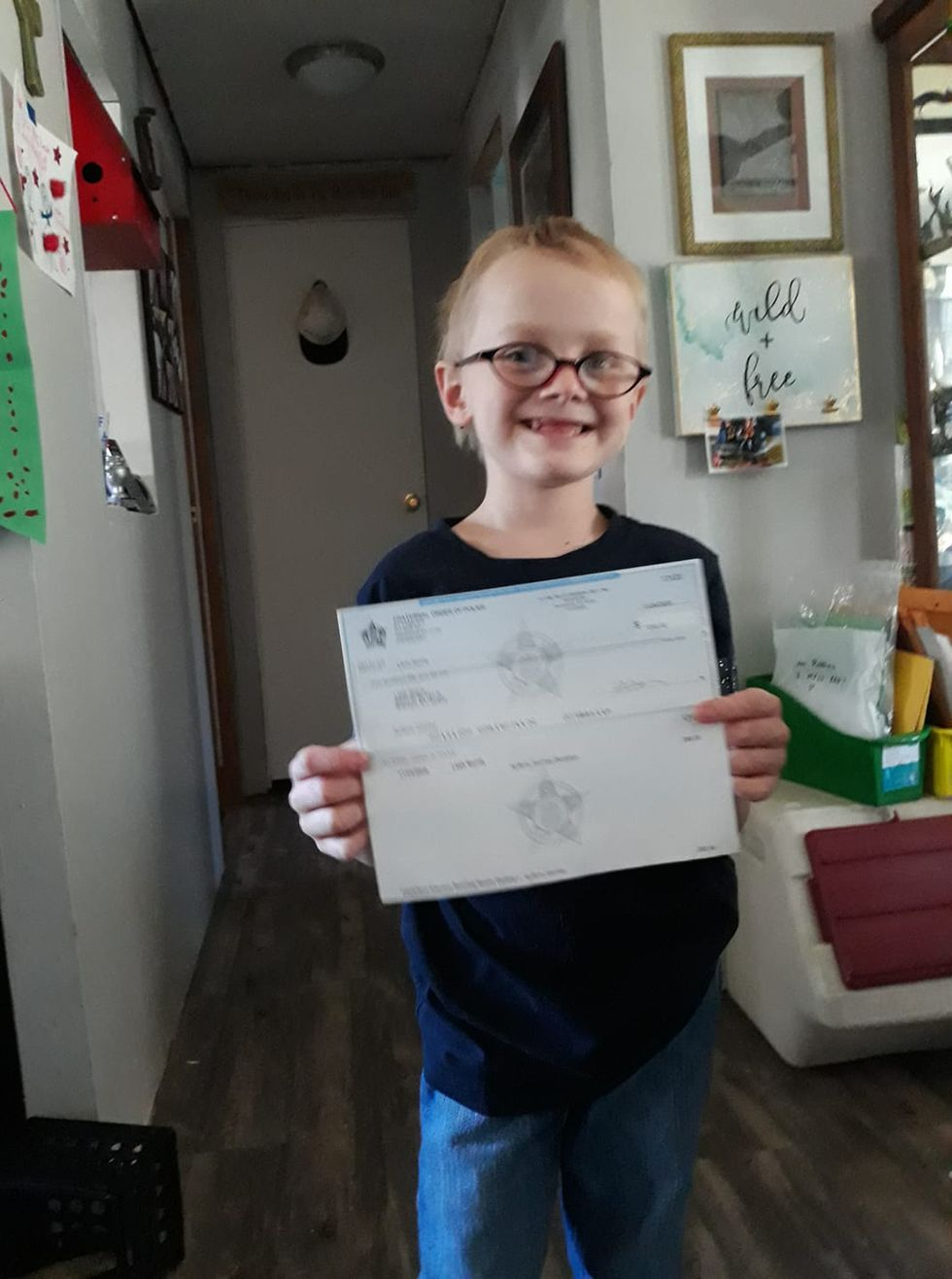 Ayden Robbins receives a check from Owensboro FOP to continue his journey.