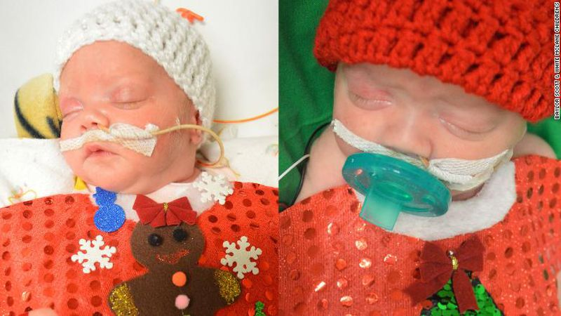 Twins, Raina and Riley, wearing their first Christmas sweaters.
