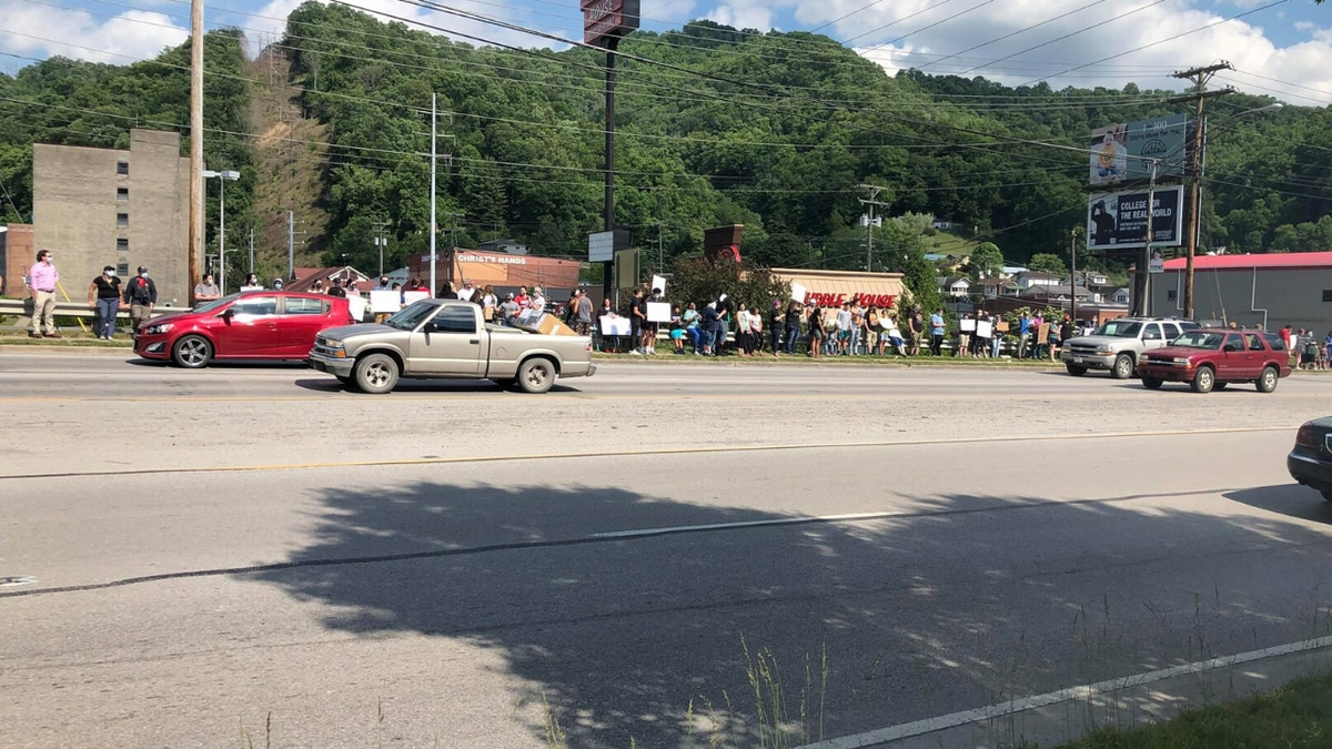 People gathering along 421 in Harlan in protest. Photo Credit: Will Puckett