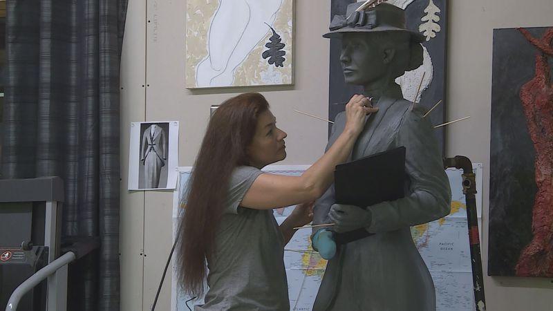 Amanda Matthews works on the statue of Nettie Depp in her Lexington studio.