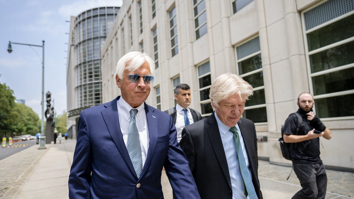 In this  Monday, July 12, 2021 file photo, Horse trainer Bob Baffert, left, leaves federal...