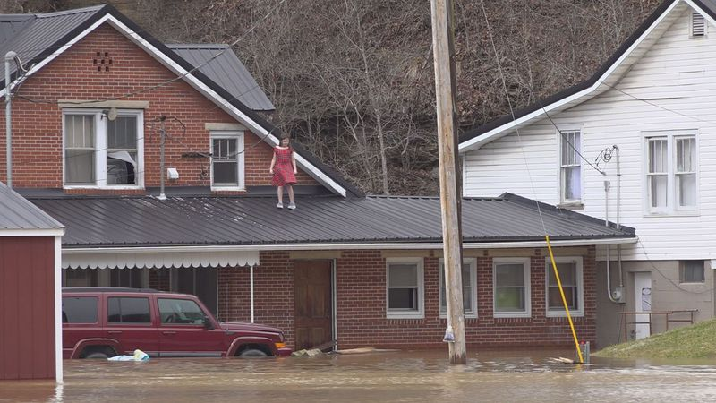 Homes and businesses in Magoffin County are surrounded by floodwaters.