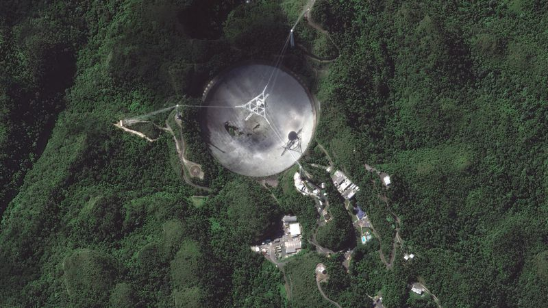 This satellite image provided by 2020 Maxar Technologies shows the damaged radio telescope at...