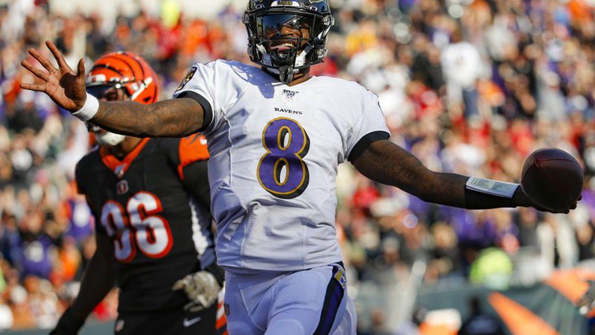 Baltimore Ravens quarterback Lamar Jackson (8) celebrates his touchdown during the second half of NFL football game against the Cincinnati Bengals, Sunday, Nov. 10, 2019, in Cincinnati.