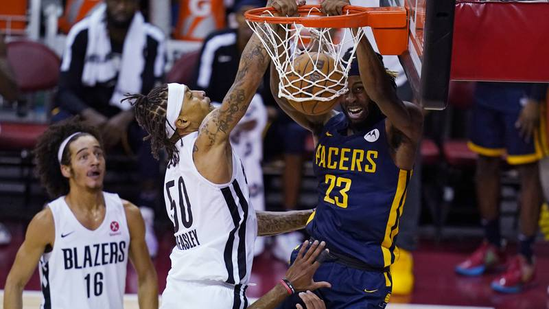 Indiana Pacers' Isaiah Jackson dunks against Portland Trail Blazers' Michael Beasley during the...