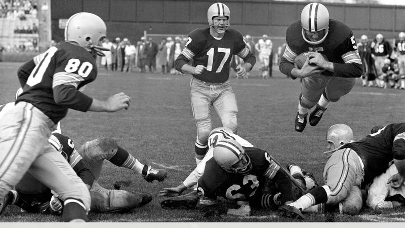 Green Bay Packers halfback Paul Hornung (5) plunges over the line for touchdown against the San...