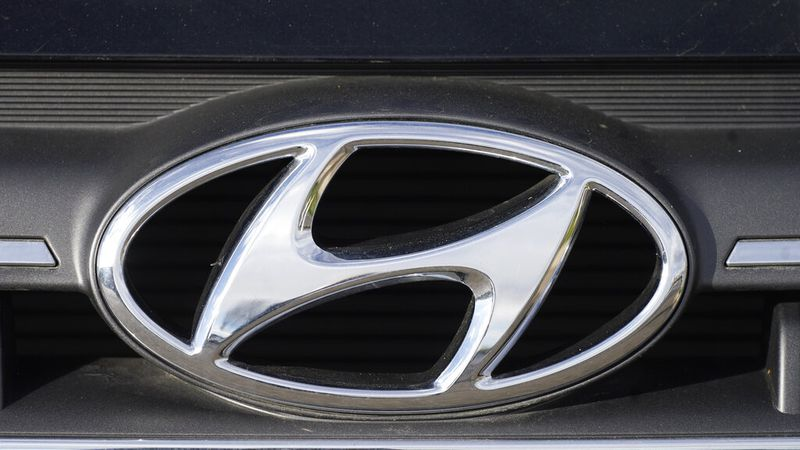 The company logo accents the grille of an unsold 2020 Elantra sedan at a Hyundai dealership...