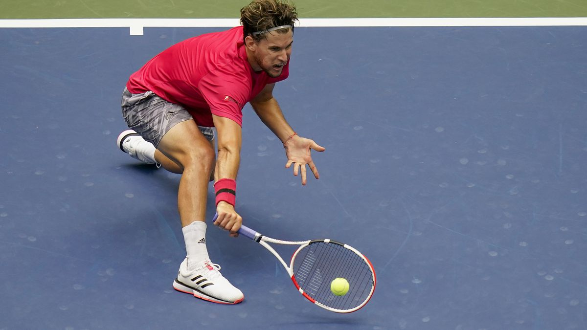 Dominic Thiem, of Austria, returns a shot to Alexander Zverev, of Germany, during the men's singles final of the US Open tennis championships, Sunday, Sept. 13, 2020, in New York.