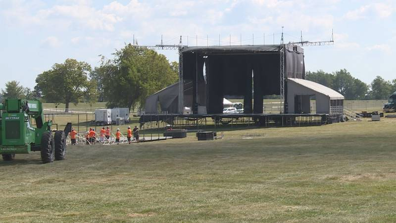Crews put the finishing touches on one of the three stages bands will be performing on at the...