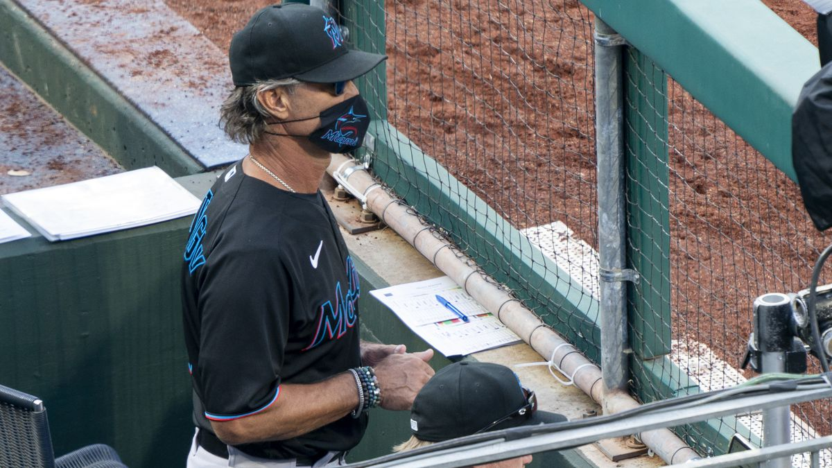 Miami Marlins' manager Don Mattingly looks out from the dugout during the eighth inning of a baseball game against the Philadelphia Phillies, Saturday, July 25, 2020, in Philadelphia. (AP Photo/Chris Szagola)