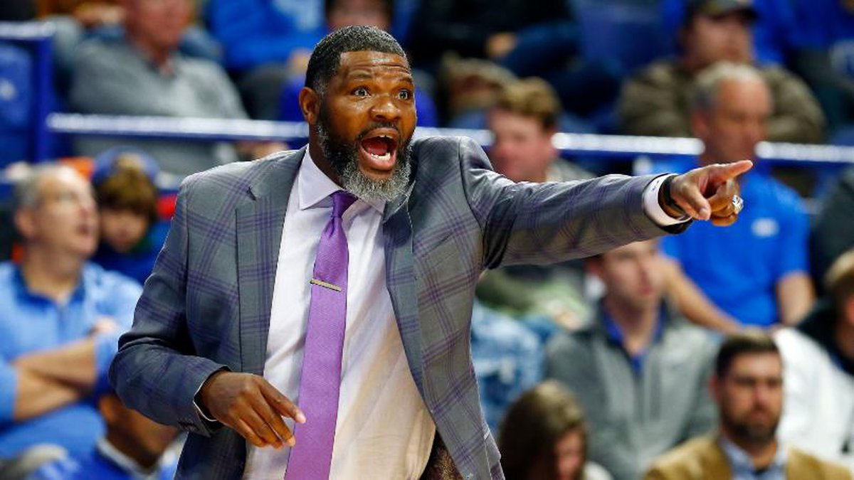 Evansville coach Walter McCarty directs his team during the first half of an NCAA college...