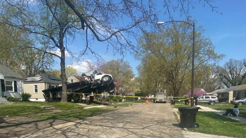 A crane has fallen onto a home in the 1100 block of Plato Terrace on Louisville's west side.