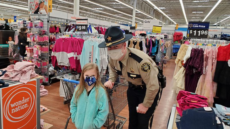Various law enforcement and rescue gathered at Walmart in London to take area kids on a...