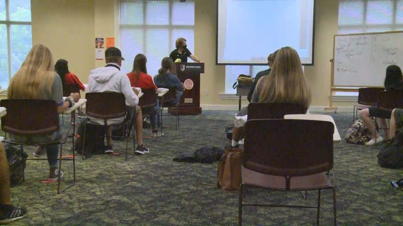Many classes at Georgetown College are being taught outside, or in larger rooms where social...