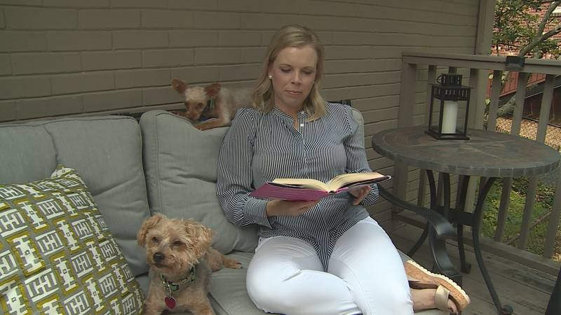 Liz Toombs, a melanoma survivor reads on her patio.