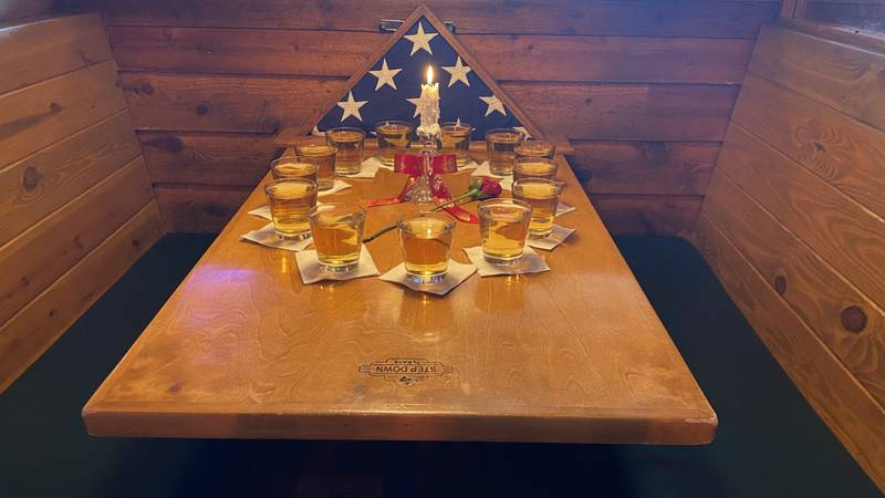 A Texas Roadhouse booth is set aside to honor the lives of American Service Members killed in...
