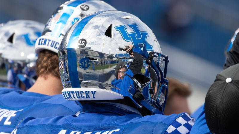 Kentucky players had a J.S. on their helmets to honor assistant coach John Schlarman who passed...