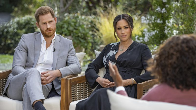 This image provided by Harpo Productions shows Prince Harry, left, and Meghan, Duchess of...